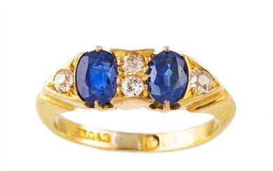 A SAPPHIRE AND DIAMOND FIVE STONE RING, set with oval sapphi...