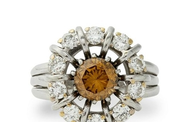 A fancy yellow-brown diamond and diamond cluster ring.