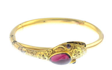A late 19th century gold garnet snake hinged bangle.