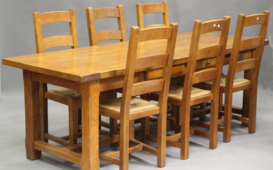 A late 20th century French oak rectangular dining table, fitted with two frieze drawers, on block le