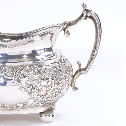 A late Victorian silver 2-handled sugar bowl, relief embosse...