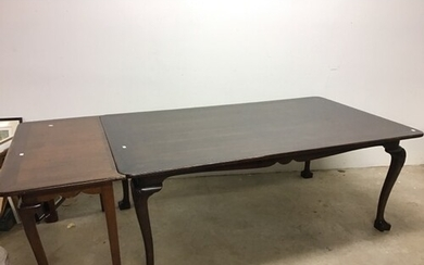 A modern South East Asian hard wood dining table with single...