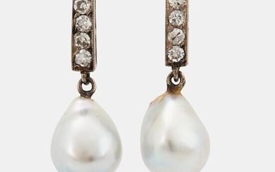 A pair of 18K white gold earrings set with drop formed pearls and eight-cut diamonds