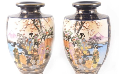 A pair of Japanese Satsuma shouldered vases decorated with two panels of colourful figures in a garden.