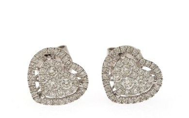 A pair of diamond ear studs in shape of hearts each set with numerous brilliant-cut diamonds totalling app. 0.79 ct., mounted in 18k white gold. (2)
