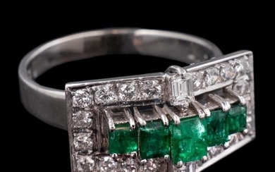 A platinum, emerald and diamond rectangular cluster ring in ...