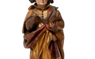 A polychrome painted carved limewood figure of Luke the Evangelist