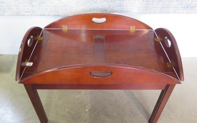 A reproduction butlers tray on stand, converts to a coffee t...