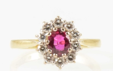 A ruby and diamond oval cluster ring.
