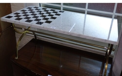 A white marble rectangular coffee table, with inset games to...