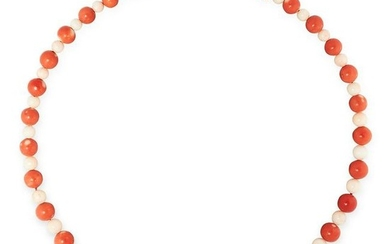 AN ANTIQUE CORAL AND ANGEL CORAL BEAD NECKLACE