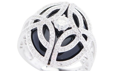 AN ONYX AND DIAMOND DRESS RING