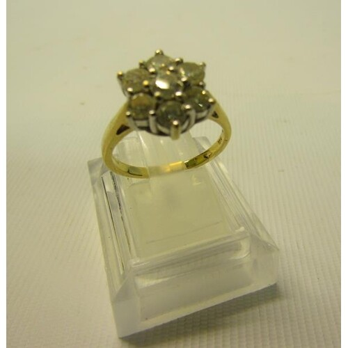 An 18ct yellow gold and platinum set diamond cluster ring of...