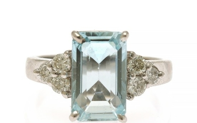 An aquamarine and diamond ring set with an emerald-cut aquamarine weighing app. 3.43 ct. flanked by siz brilliant-cut diamonds, mounted in 14k white gold.