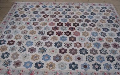 An early 20th Century hand stitched cotton patchwork Quilt...