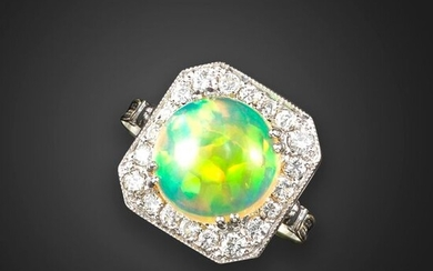 An opal and diamond cluster ring, the opal cabochon set within an octagonal surround of round brilliant-cut diamonds in white gold, size Q