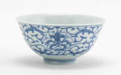 "CHINESE BLUE AND WHITE PORCELAIN BOWL With lotus flower and vine decoration. Stylized mark on base. Height 2.5"". Diameter 4.4""."