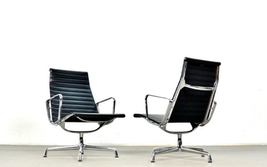 Charles & Ray Eames, a pair of lounge chairs, model EA 116 by Vitra (2)