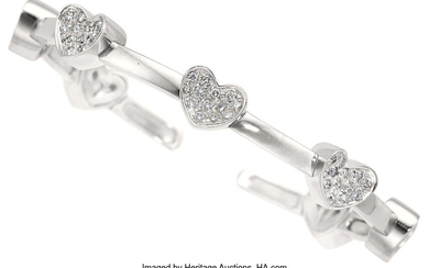 Diamond, White Gold Bracelet The heart motif cuff bracelet...