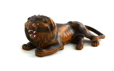 Georg O. Wild carved tiger's-eye lion
