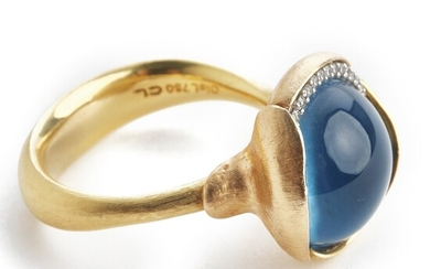 """Ole Lynggaard: A topaz and diamond ring """"Lotus"""" set with a cabochon topaz and numerous brilliant-cut diamonds, mounted in 18k gold and pink guld."""