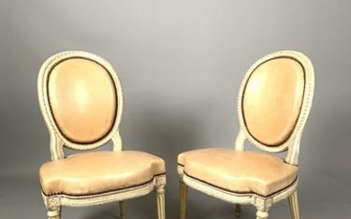 Pair of carved and cream lacquered wooden chairs...