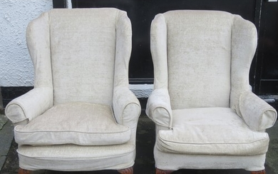 Pair of early to mid 20th century upholstered wing armchairs...