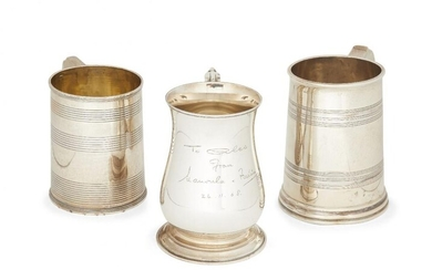 Three silver tankards, two with reeded decoration,...