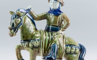 """UNUSUAL CHINESE PEACHBLOOM GLAZE PORCELAIN FIGURE In the form of a rider on horseback. Length 9.5""""."""