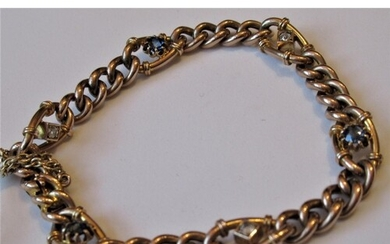 Victorian 9ct gold curb link bracelet set three sapphires an...