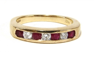 A 9ct gold ruby and diamond half eternity ring