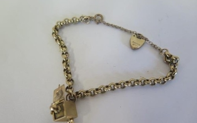 A 9ct yellow gold bracelet with Jack in the box sprung charm...