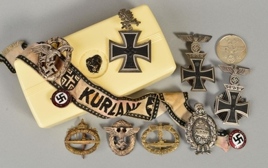 A BOX CONTAINING A NUMBER OF 3RD REICH WWII BADGES, PINS etc...