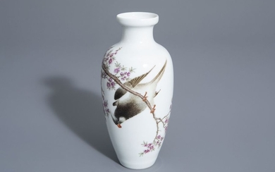 A Chinese famille rose vase with a bird...