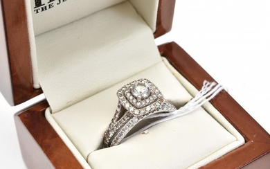 A DIAMOND DRESS RING IN WHITE GOLD WITH DIAMOND WEDDER (MISSING ONE DIAMOND), SIZE O