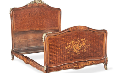 A French late 19th century gilt bronze mounted rosewood, kingwood, bois satine, amaranth marquetry and parquetry bed
