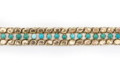 A GOLD AND TURQUOISE BRACELET