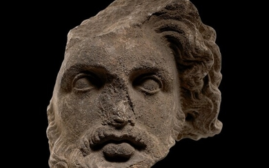 A HELLENISTIC MARBLE HEAD OF A BEARDED GOD, CIRCA 3RD CENTURY B.C.