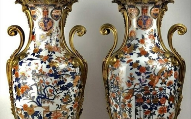 A LARGE PAIR OF ORMOLU MOUNTED PORCELAIN VASES