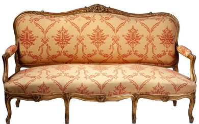 A Louis XV style carved giltwood canape