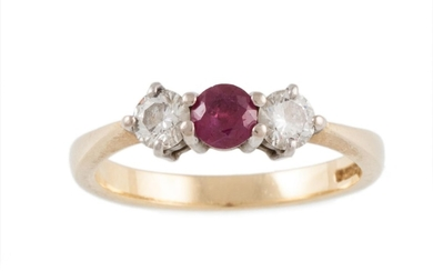 A RUBY AND DIAMOND THREE STONE RING mounted in 18ct yellow a...