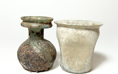 A Roman glass sprinkler bottle and an indented cup