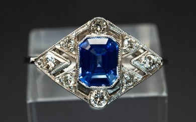 A SAPPHIRE AND DIAMOND PLATINUM RING, the tapering