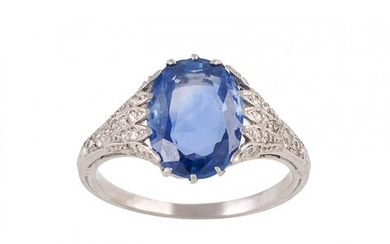 A SAPPHIRE SINGLE STONE RING, to pavé diamond shoulders, mou...