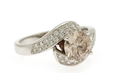 A diamond ring set with a brilliant-cut diamond weighing app. 1.40 ct. flanked by numerous brilliant-cut diamonds, mounted in 14k white gold. Size 56.