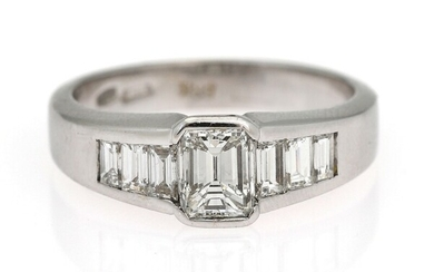 A diamond ring set with an emerald-cut diamond weighing app. 0.80 ct. flanked by diamonds,...