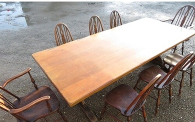 A large oak refectory dining table, solid top on trestle end...