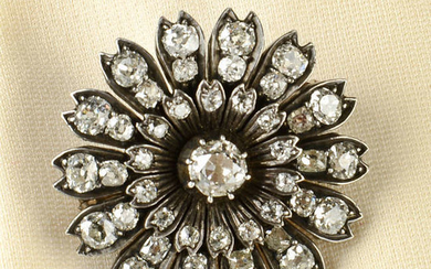 A late Victorian silver and gold old-cut diamond floral brooch.