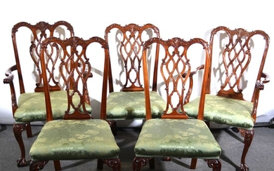 A mahogany dining table and matching set of eight chairs, in the Chippendale style