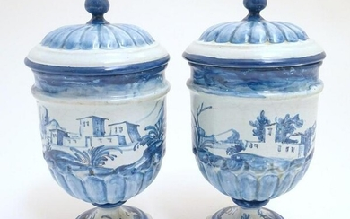 A pair of Continental blue and white pedestal jars and